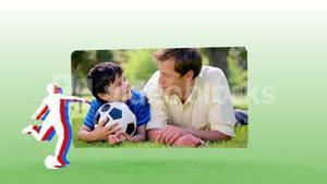 Video of a father and his son playing football