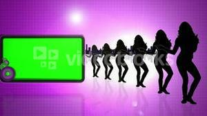 Green screens next to dancing silhouettes