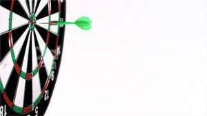 Dart being thrown in super slow motion on a dart board