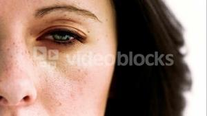 Woman opening in slow motion her eye with a camera inside