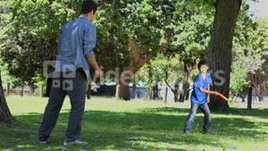 Son with his father playing frisbee
