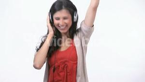 Woman jumping and dancing with headphone