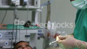 Surgeon holding a scissors during an operation