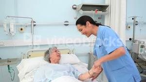 Intern holding a patient hands