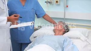 Doctor and nurse talking with a patient
