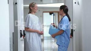 Nurse walking with a patient in a hospital