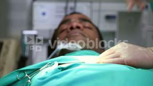 Unconscious male patient on an operating table
