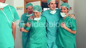 Surgery team leaving the operating room