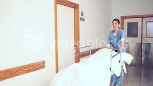 Nurses and doctor driving a patient on his bed