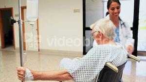 Patient in a wheelchair with a doctor