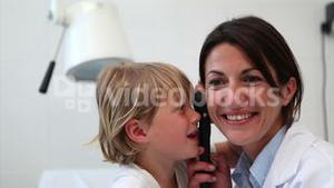 Child playing with examination tool