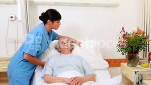 Smiling senior patient talking with a nurse