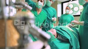 Surgeons working on a female patient