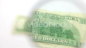 Magnifying glass in front of a banknote