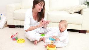 Woman and a baby playing with a toy