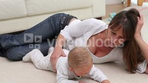 Woman lying with a baby