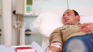 Transfused patient with closed eyes