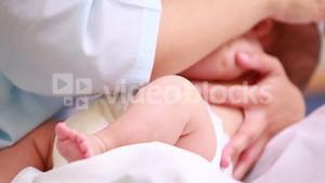 Mother breastfeeding a baby