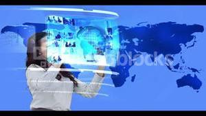Woman searching through interactive media library on world map background
