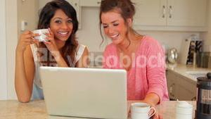 Women laughing at laptop