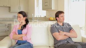 Couple not talking with arms crossed