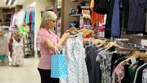 Woman looking for clothes in a shop
