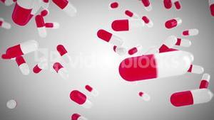 Pink and white pills falling