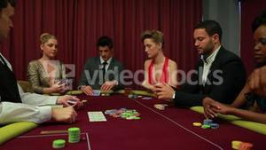 Dealer dealing poker cards and bets are being placed