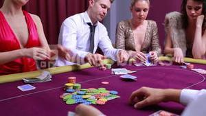 Woman going all in and other people at table folding