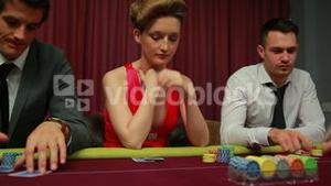 Woman looking at her poker hand