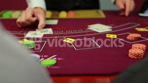 Dealer dealing poker cards