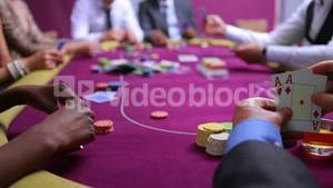 People placing bets with one man seeing his amazing hand and going all in