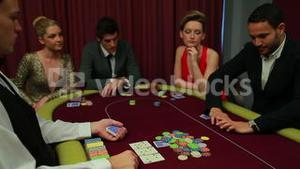 Four people playing poker and one going all in