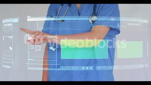 Doctor scrolling though interactive menu with copyspace