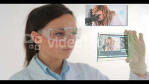 Scientist watching videos of research