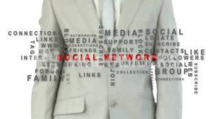 Business man pushing the social network button