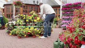 Man and child buying flowers