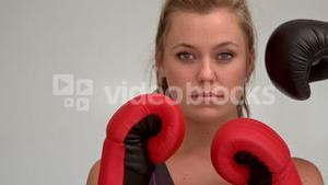 Female boxer being hit with boxing glove