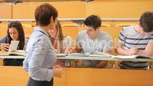 Students sitting at the desk at the lecture hall