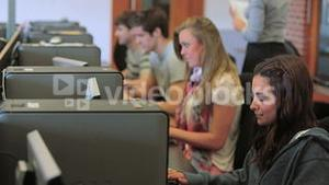 Students working concentrated on the computer