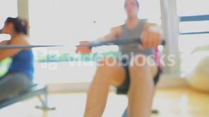 Brunette man working out on row machine