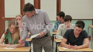 Teacher collecting tests