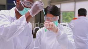People experimenting with the green liquid