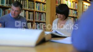 People studying in the library together