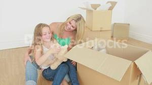 Video of mother and daughter unpacking