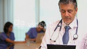 Close up of doctor with clipboard