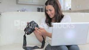 Video of woman viewing photos in photo camera