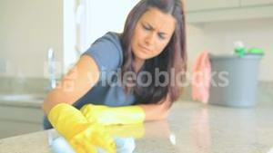 Video of woman cleaning kitchen counter