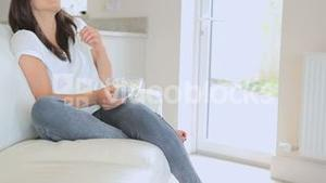 Woman relaxing in front of the television