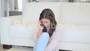 Video of smiling brunette woman phoning